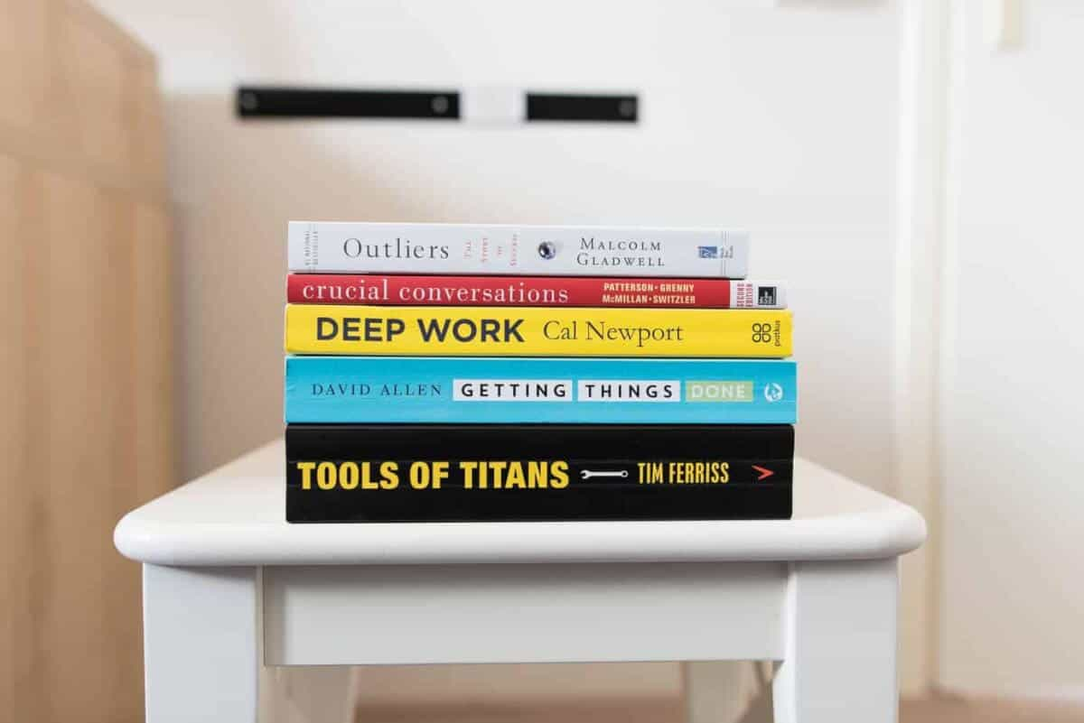 Stack of self-help books on a table